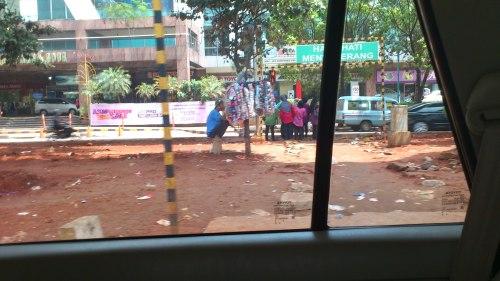 jakarta street stall, jakarta man at work