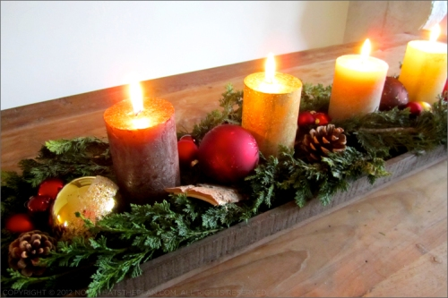 christmas pine cone and candle centrepiece