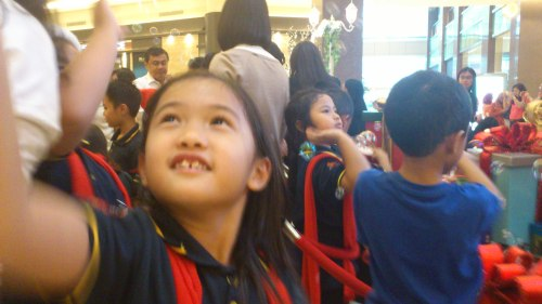 girl chasing bubbles in Pacific Place Jakarta