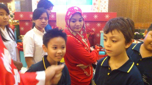 Lady in red watching magic show in jakarta