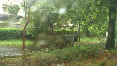 jakarta rubbish colletor braving rain