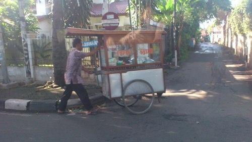 man selling breakfast jakarta street