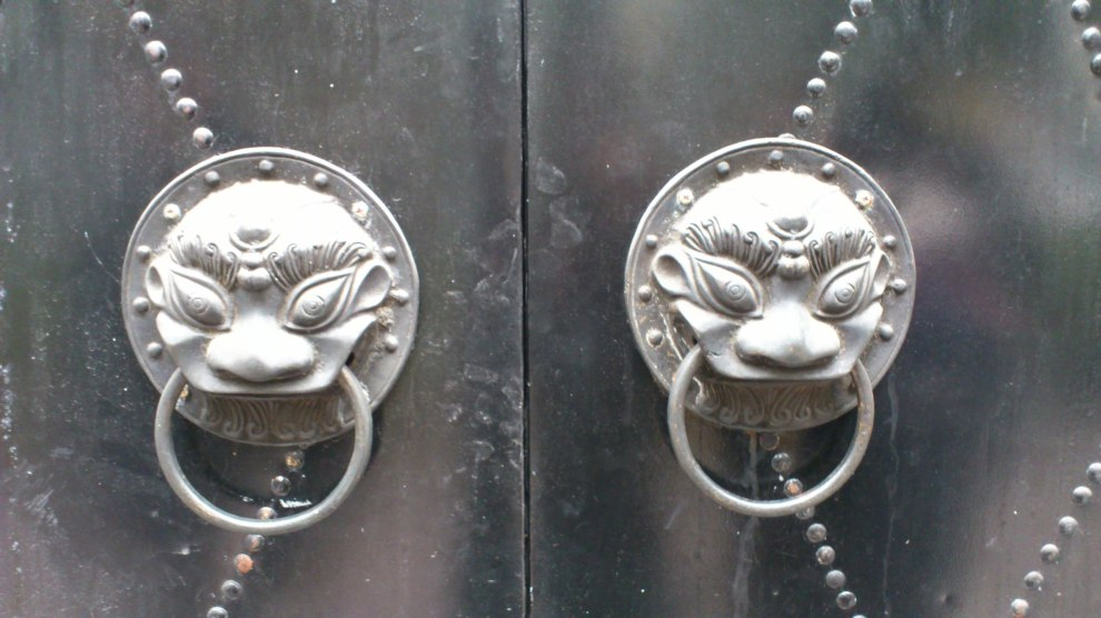 lion heads on door, shanghai china